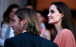 Angelina Jolie amerikai színésznő és élettársa, Brad Pitt amerikai színész érkezik a 17. szarajevói nemzetközi filmfesztiválra 2011. július 30-án