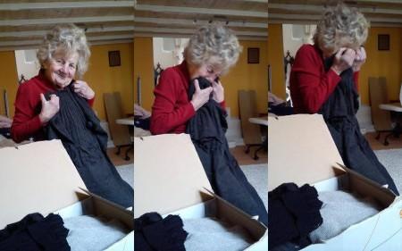 A 81 éves Ica néni örömmel fogadja a neki ajándékozott ruhákat (Forrás: Facebook)