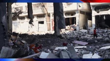 Lebombázott épület a Gázai-övezetben